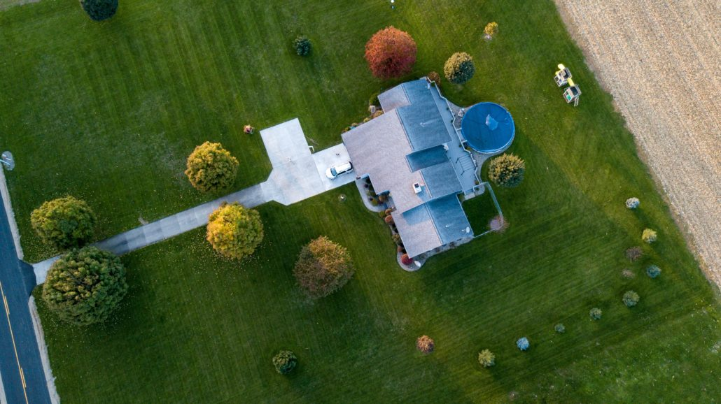 Aerial view of a beautiful lawn - Mole tunnels can cause damage to your property - if you've noticed raised ridges from tunnels, it's more than likely you have a mole problem underfoot!